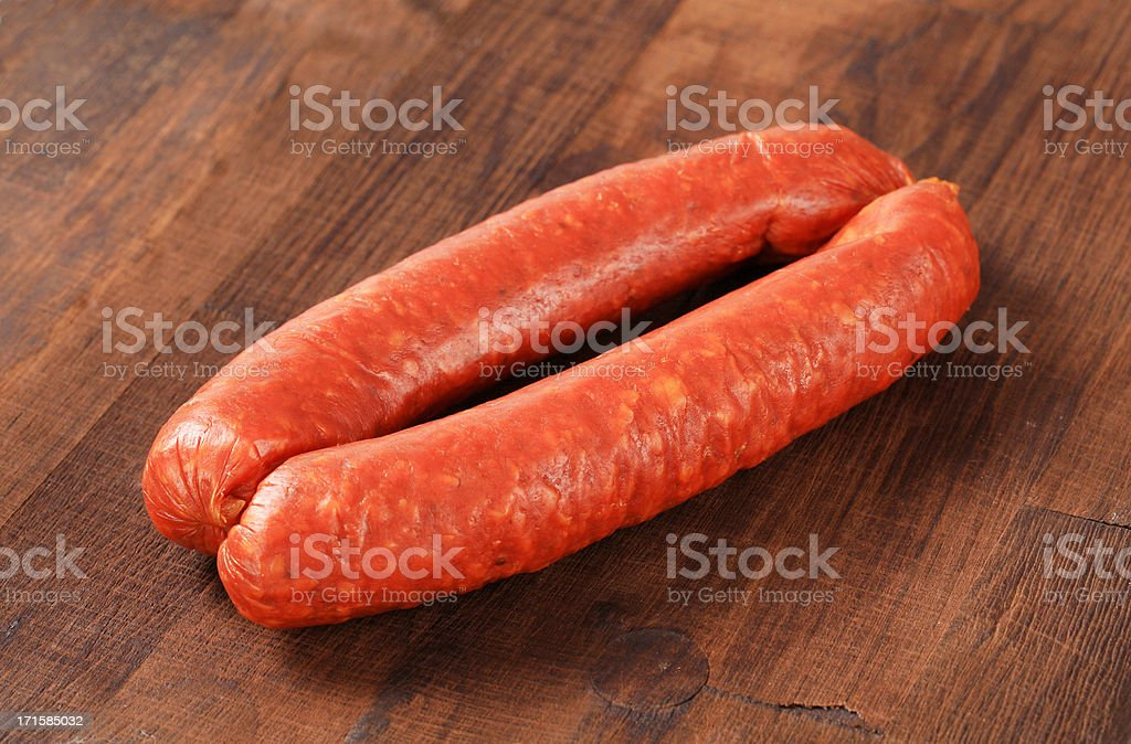 Pair of sausages on a wooden table royalty-free stock photo