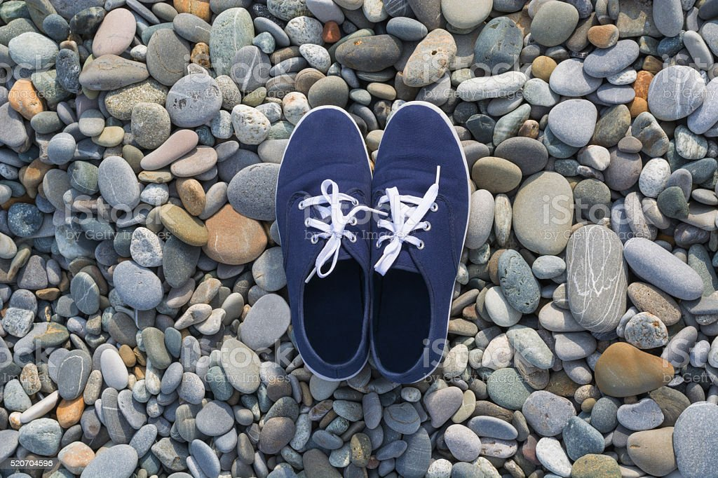 Pair of shoes on stones stock photo
