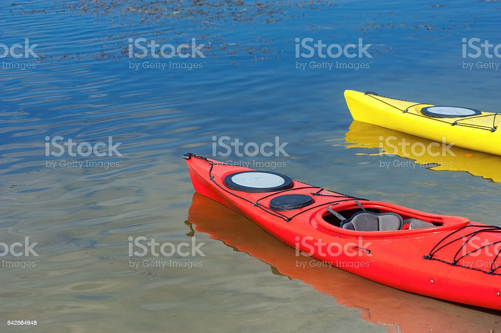 pair of single kayaks in a row stock photo