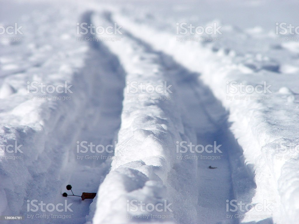 Pair of ski tracks stock photo