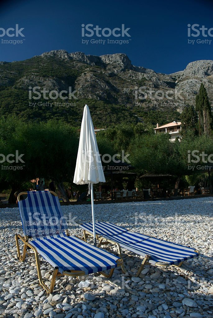 Pair of Striped Chairs Rocky Beach royalty-free stock photo