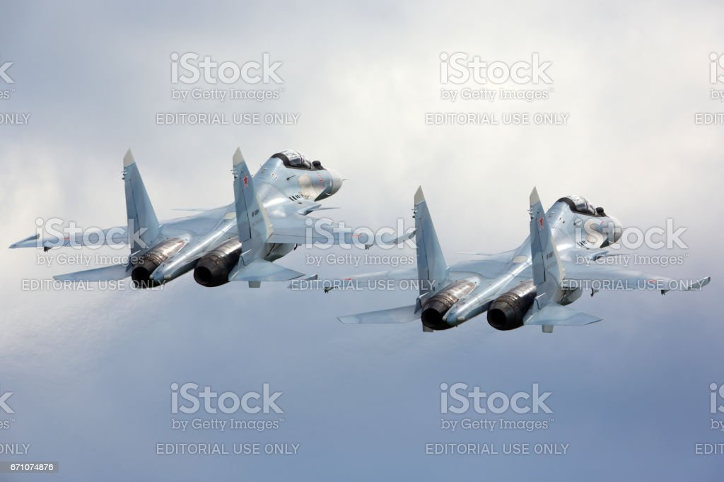 KUBINKA, MOSCOW REGION, RUSSIA - JUNE 17, 2015: Pair of Sukhoi Su-30SM RF-91815 jet fighters take off at Kubinka air force base during Army-2015 forum. stock photo