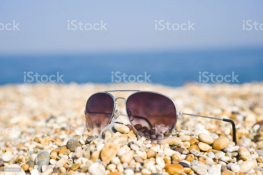 Pair Of Sunglasses Lying On The Beach royalty-free stock photo