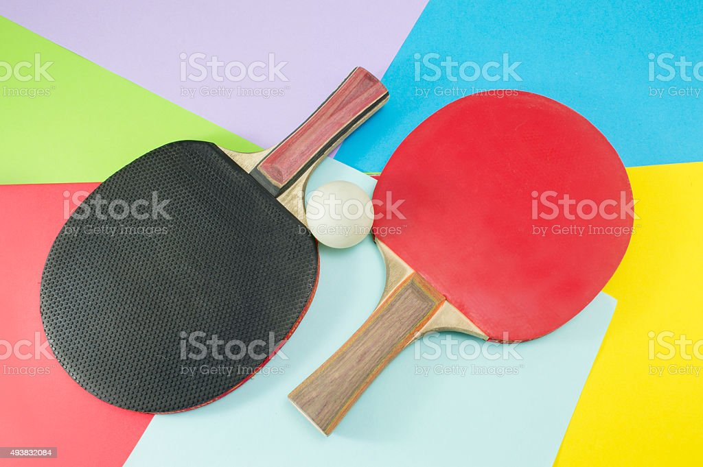 Pair of table tennis rackets on a collage background stock photo