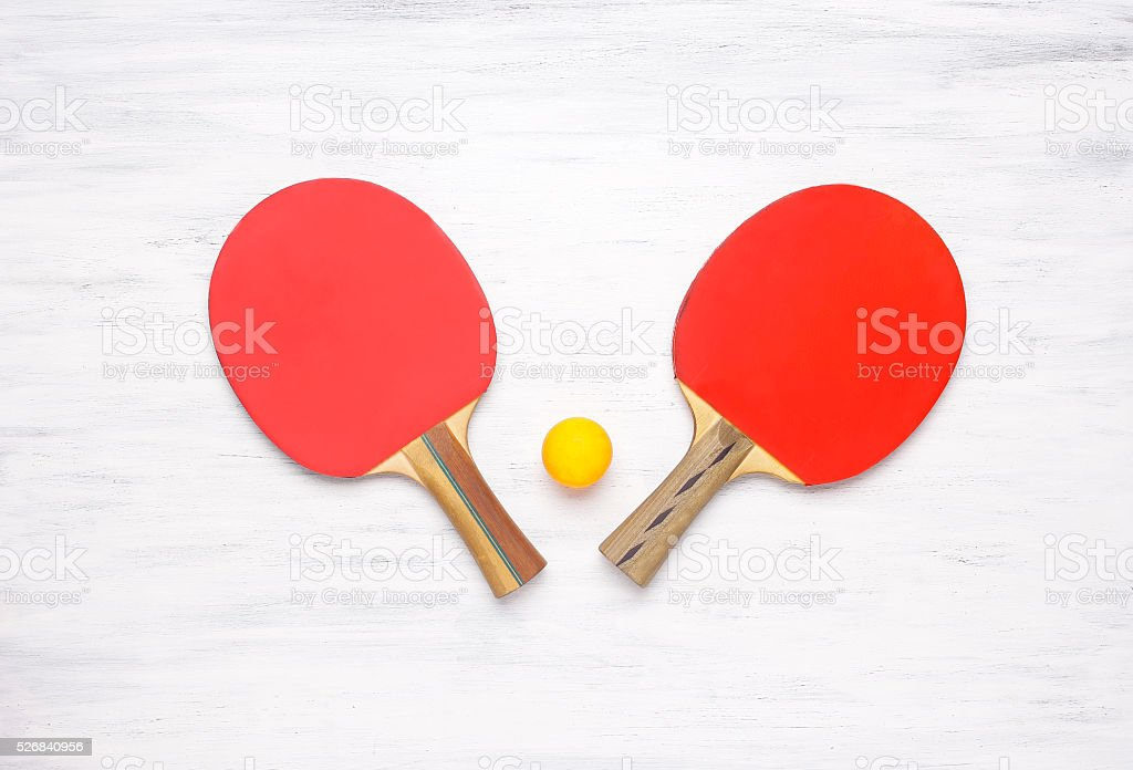 Pair of table tennis rackets on a wooden background stock photo