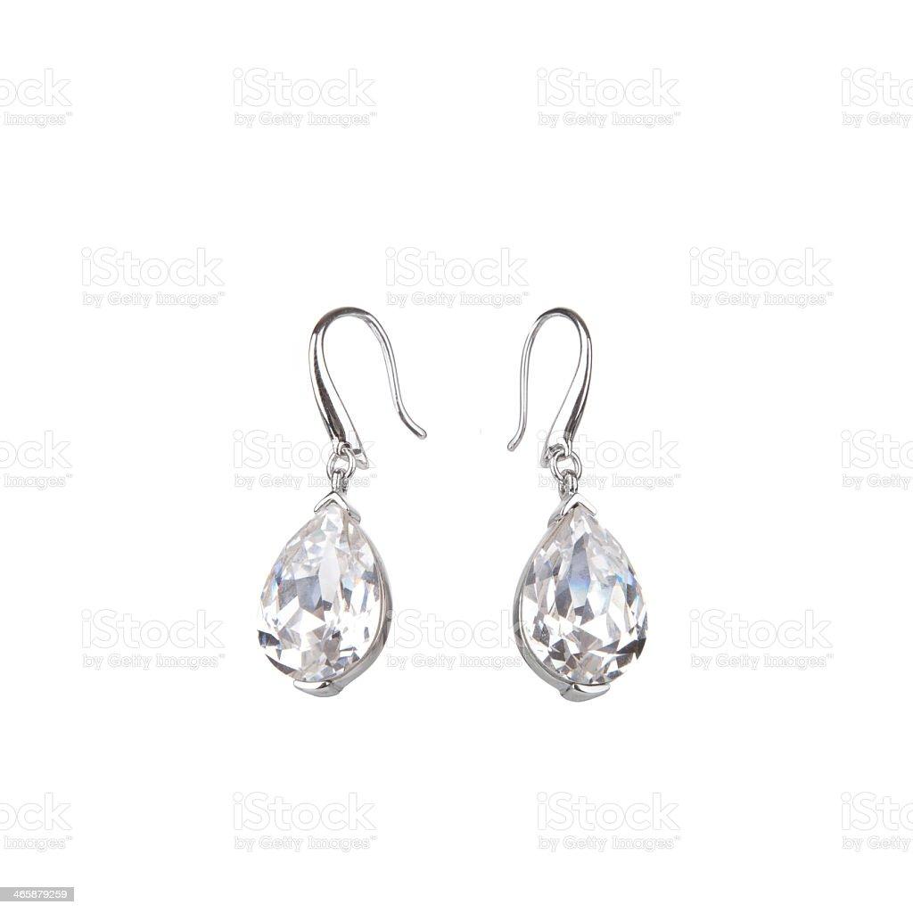 Pair of tear drop shaped diamond earrings stock photo