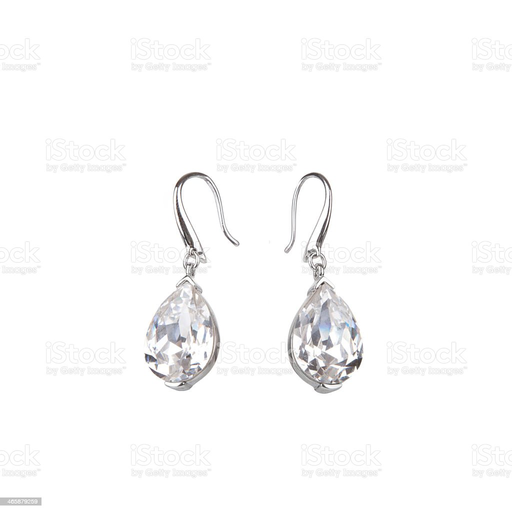 Pair of tear drop shaped diamond earrings stock photo