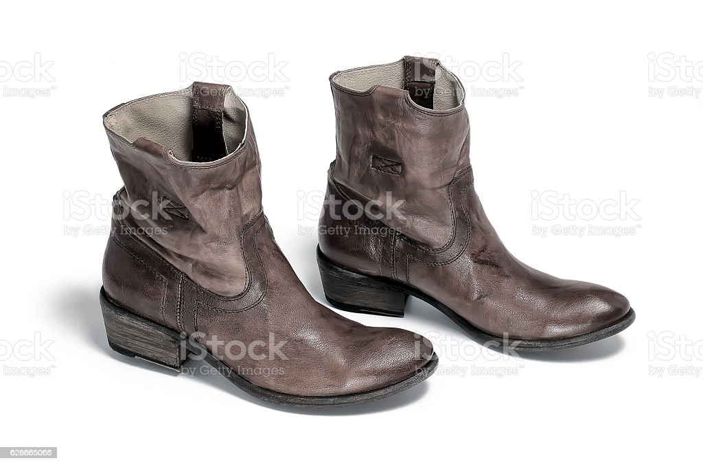 Pair Of Traditional Cowboy Boots Retro Tone stock photo 628665066