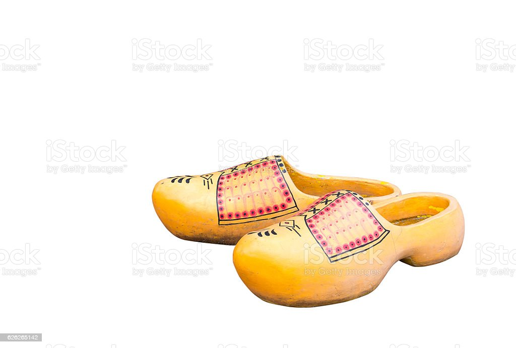 Pair of traditional Dutch yellow concrete shoes isolated on  white stock photo
