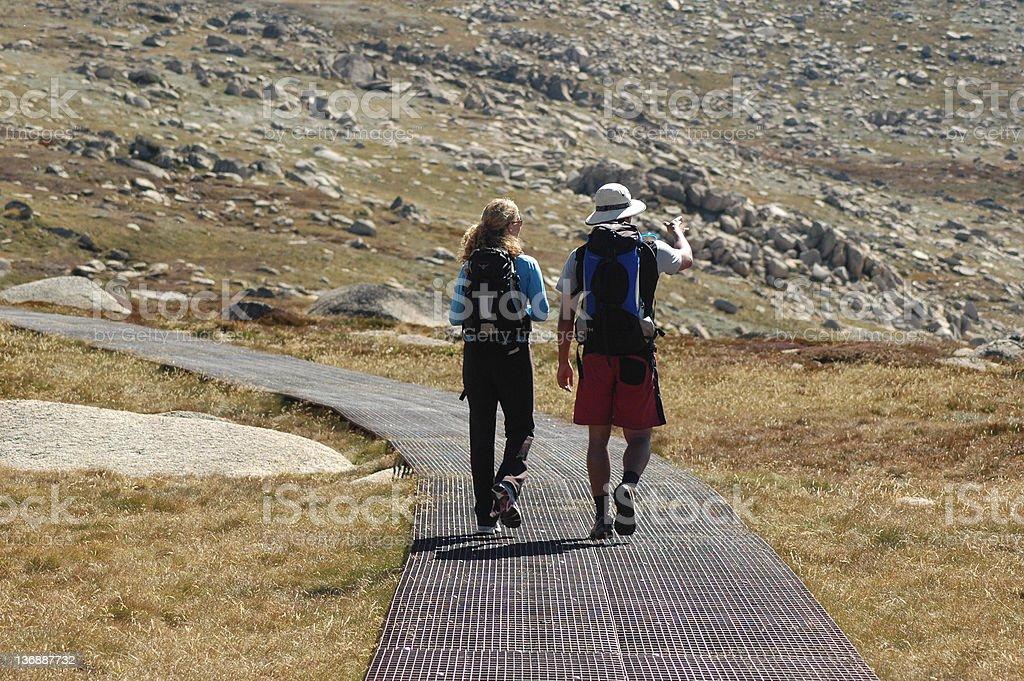 Pair of Trekkers on Mount Kosciusko, Australia stock photo