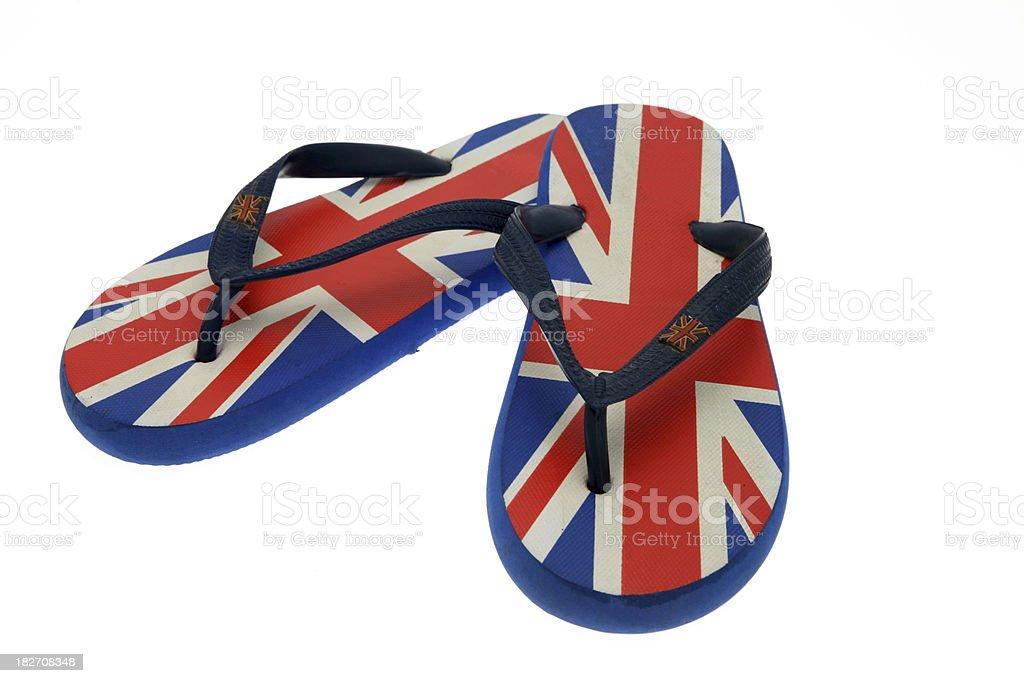 Pair of UK flag pattern flip-flops on white royalty-free stock photo