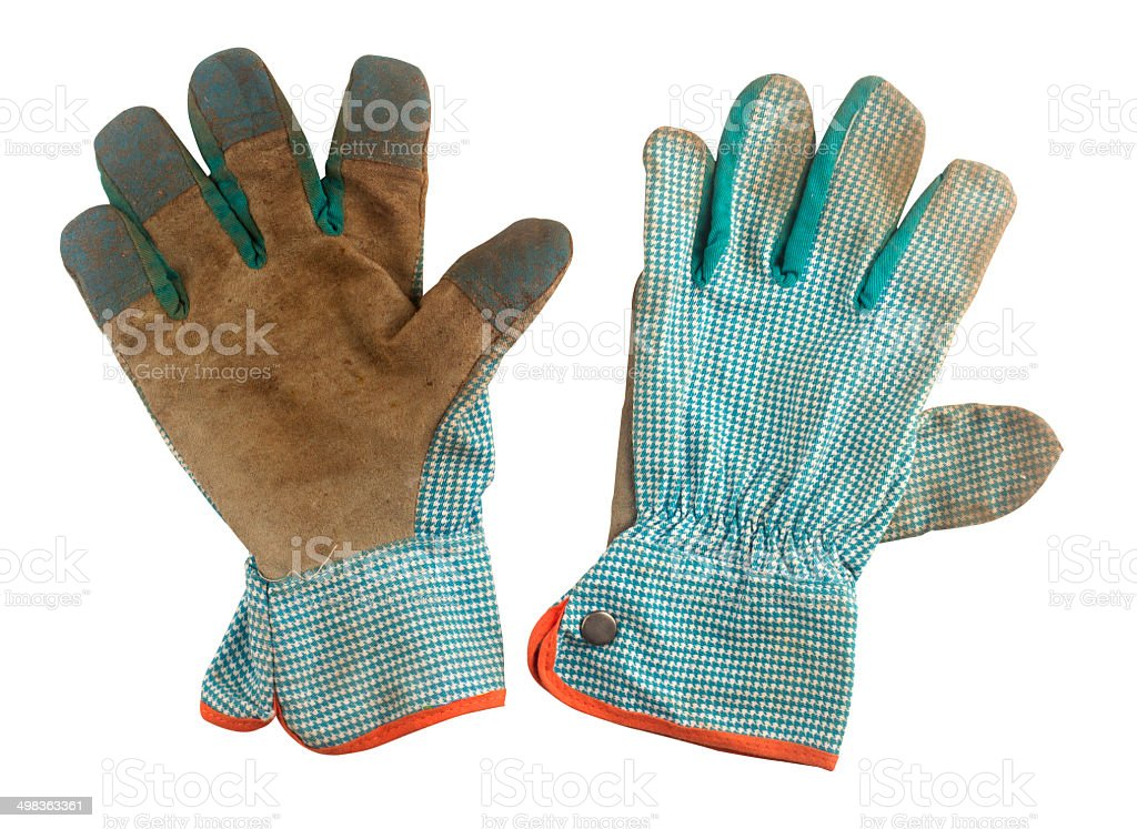 Pair of used working gloves stock photo