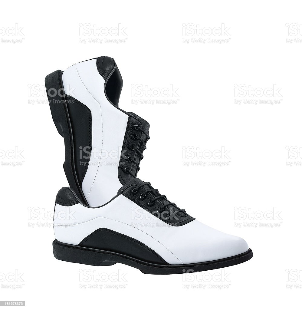 pair of white golf shoes isolated royalty-free stock photo