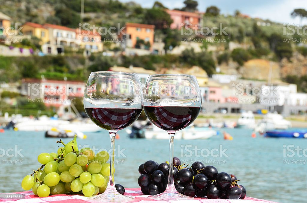 Pair of wineglasses and grapes royalty-free stock photo