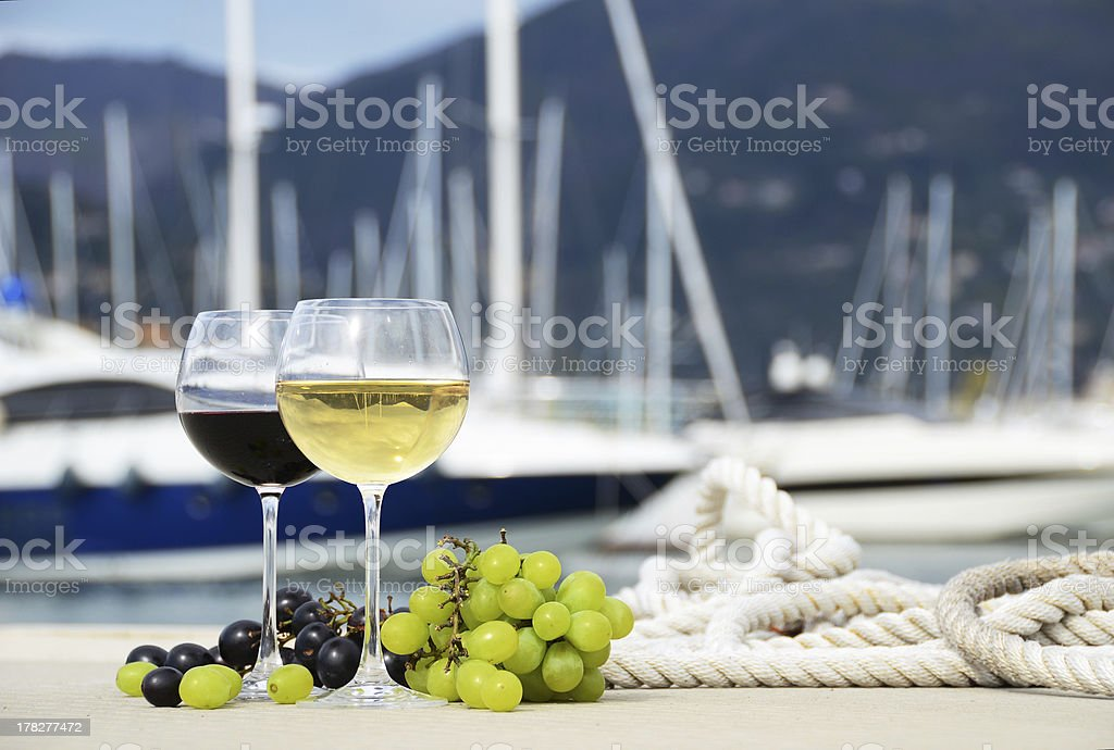 Pair of wineglasses on the yacht pier stock photo