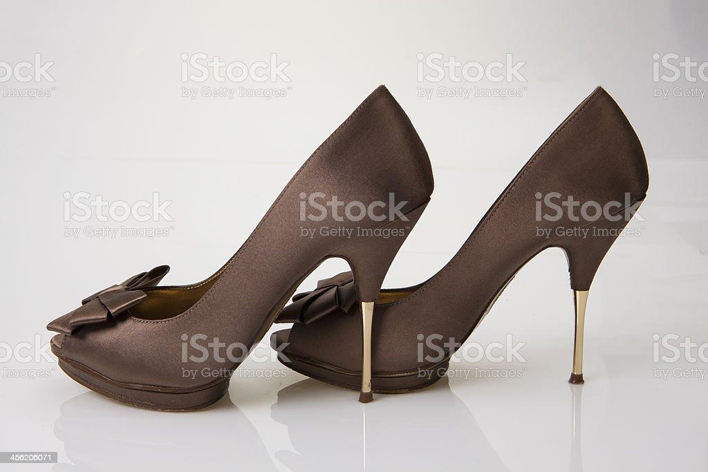 Pair of women's satine high heel shoes stock photo