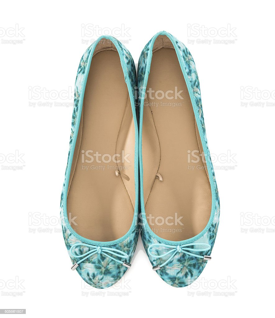 Pair of women's turquoise low heel shoes with floral pattern stock photo