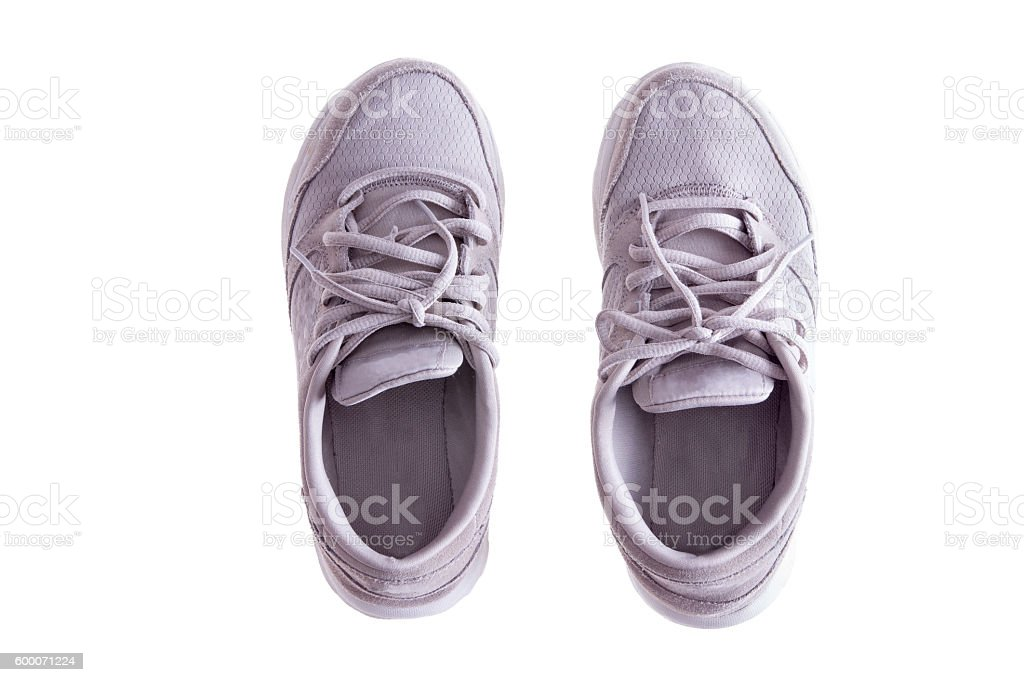 Pair of Worn White Sneakers on White Background stock photo