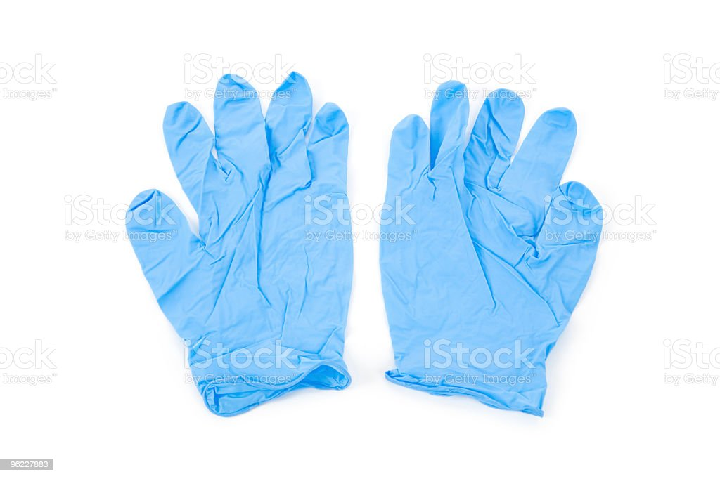 A pair of wrinkled blue latex gloves stock photo