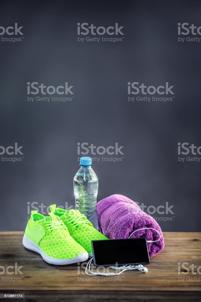 Pair of yellow green sport shoes towel water smart pone stock photo