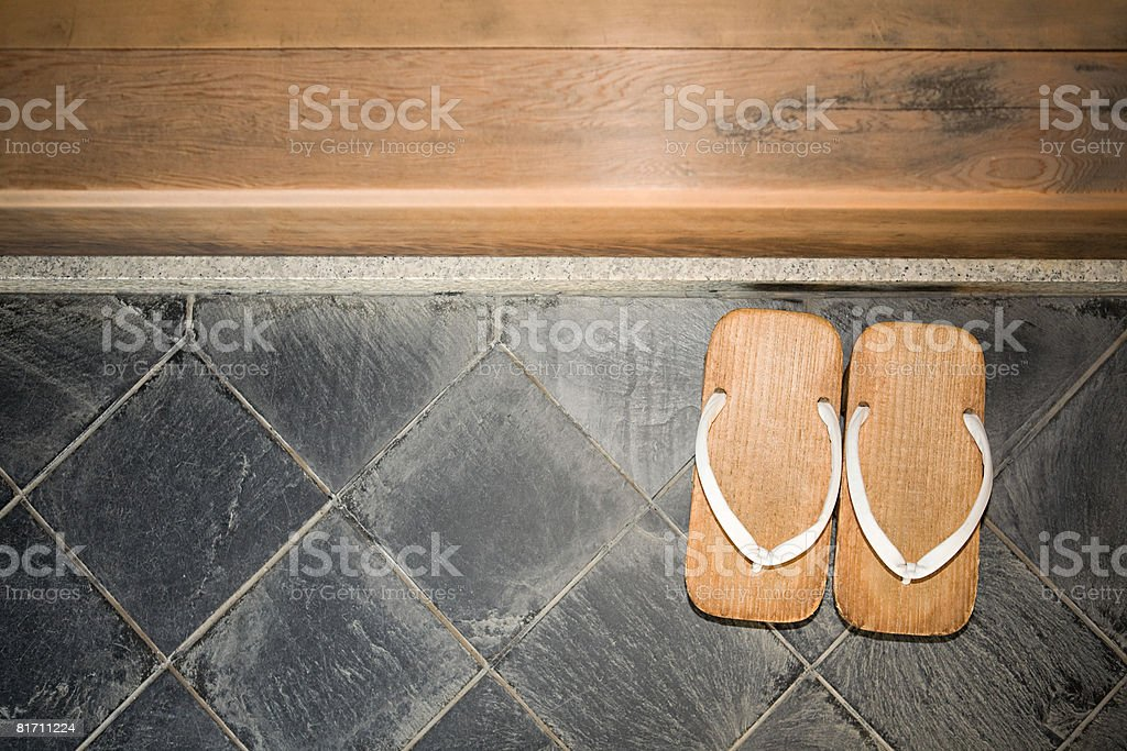 Pair of zori sandals on floor stock photo