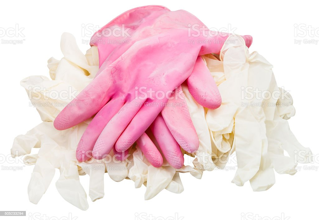 pair ofused pink protective gloves on new gloves stock photo