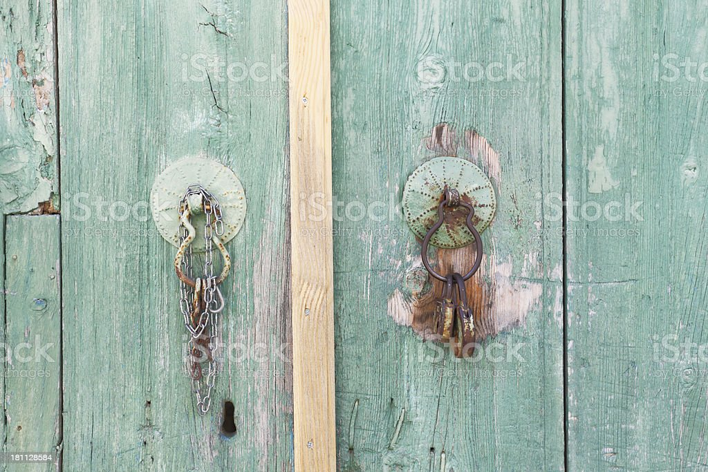 pair old village door handle doorknocker green wood Cyprus royalty-free stock photo