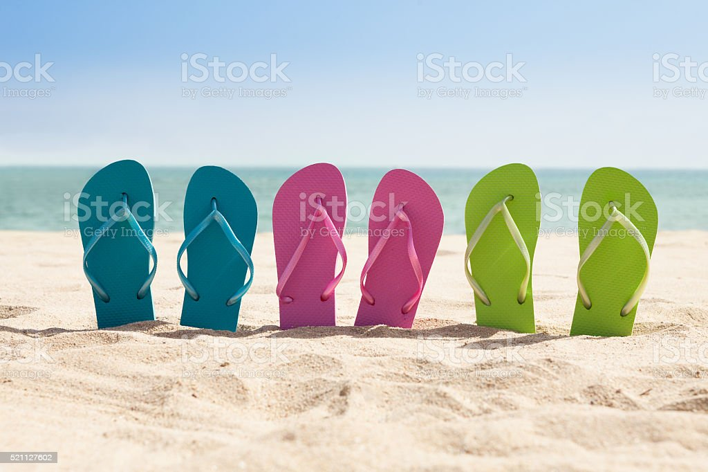 Pairs Of Flip-flops On Beach stock photo
