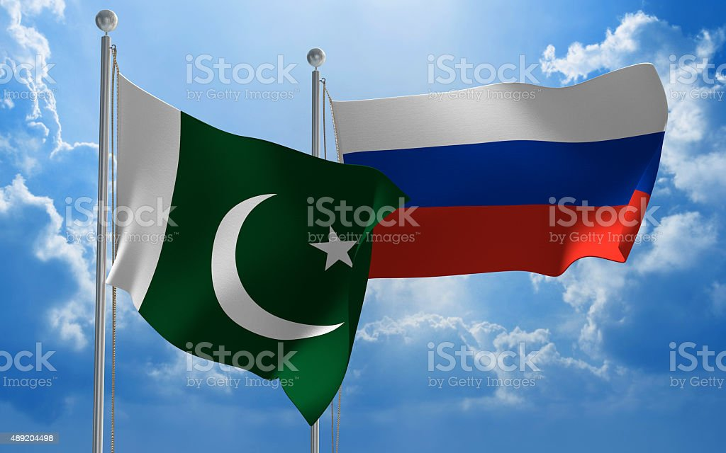 Pakistan and Russia flags flying together for diplomatic talks stock photo