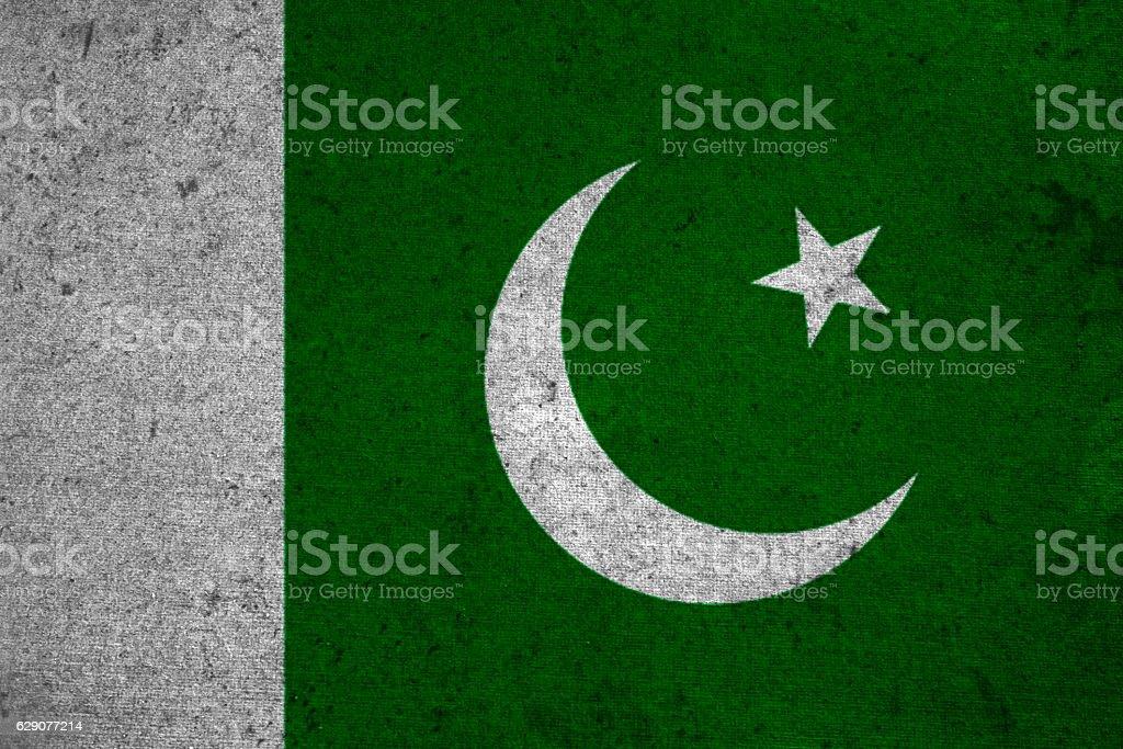 pakistan flag on an old grunge background stock photo