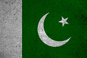 pakistan flag on an old grunge background