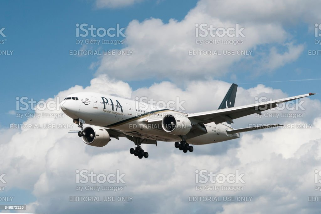 Pakistan International Airlines airplane lands stock photo