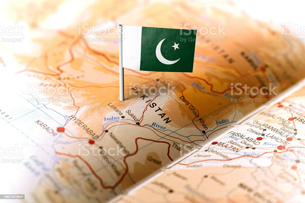 Pakistan pinned on the map with flag stock photo