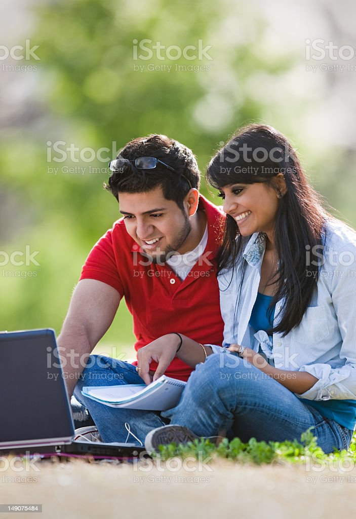 Pakistani College Students Studying Outdoors royalty-free stock photo