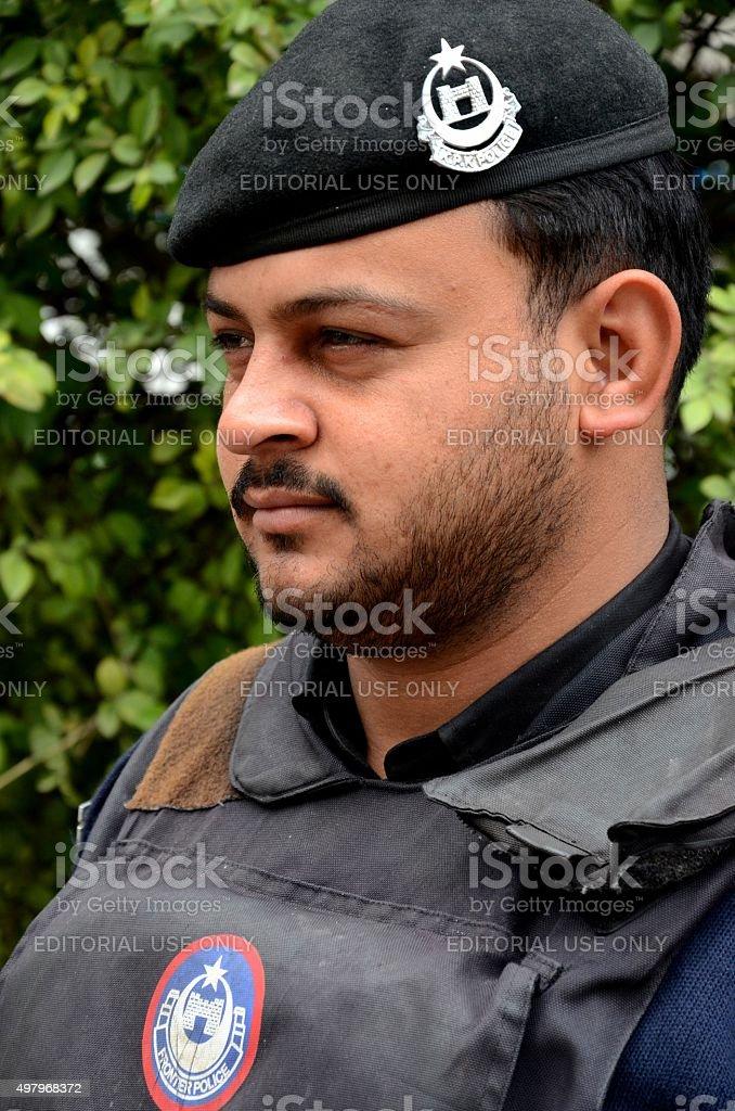 Pakistani police officer with beret Peshawar Pakistan stock photo