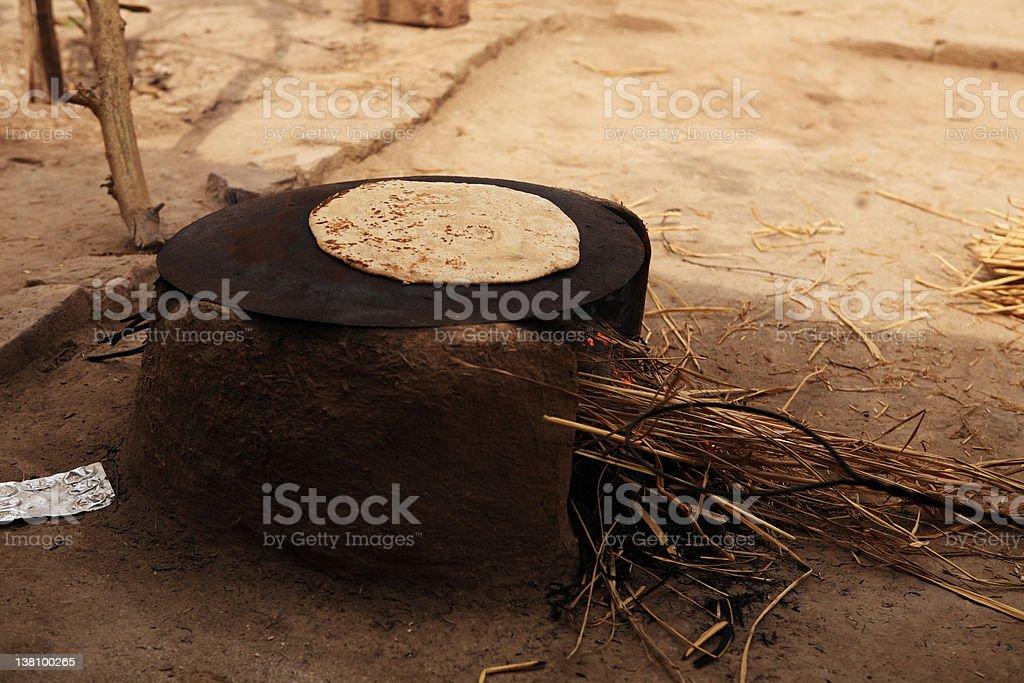 Pakistani Village Lifestyle Making Chapati Mud Stove stock photo