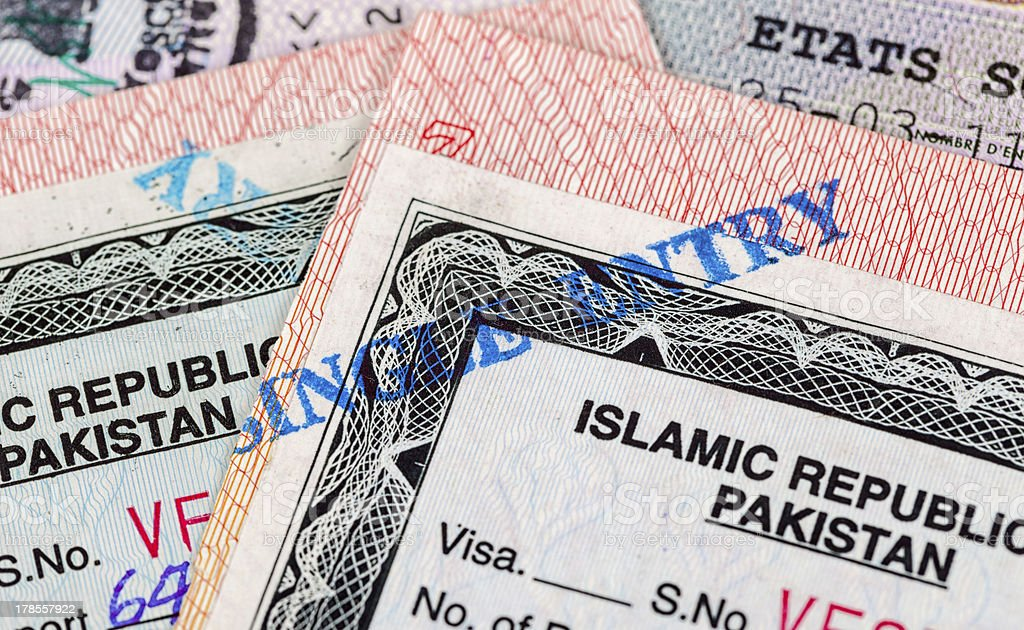 Pakistani Visa entry and exit stamps in passport royalty-free stock photo