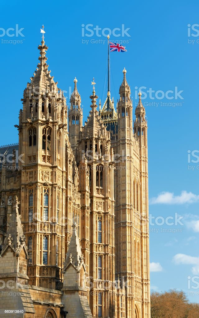 Palace of Westminster, Victoria Tower with British flag on top stock photo