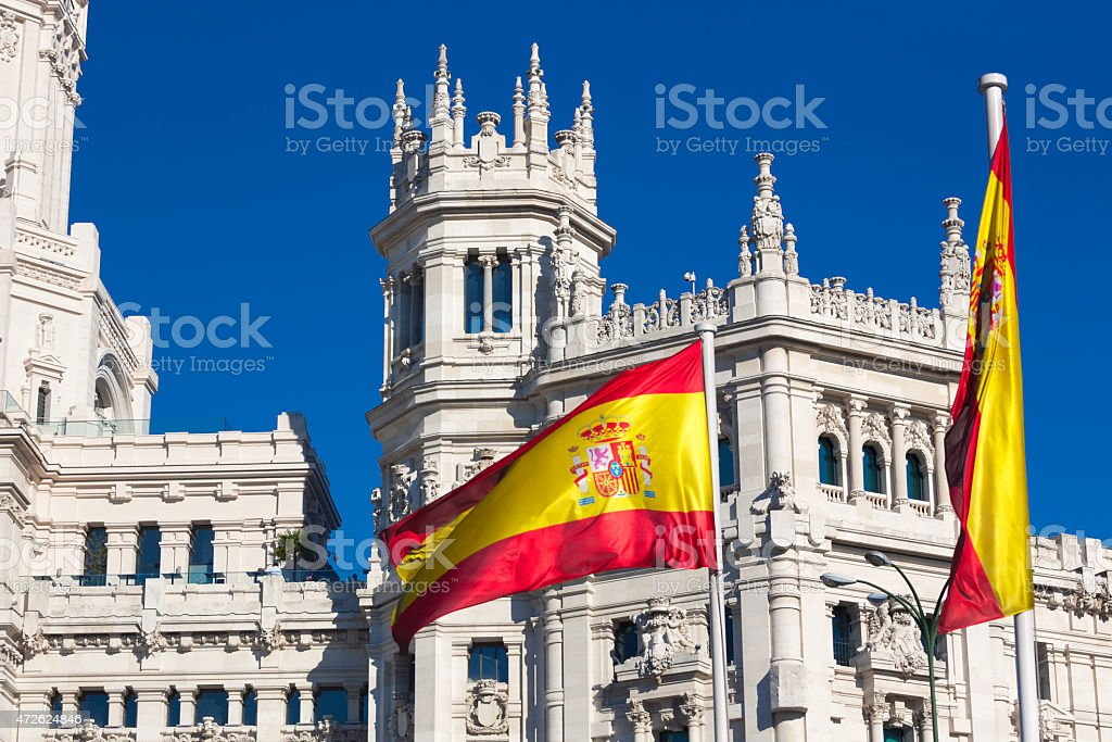 Palacio de Cibeles and spanish flag stock photo