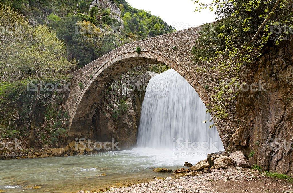 Palaiokarya bridge and waterfall, Thessaly, Greece stock photo
