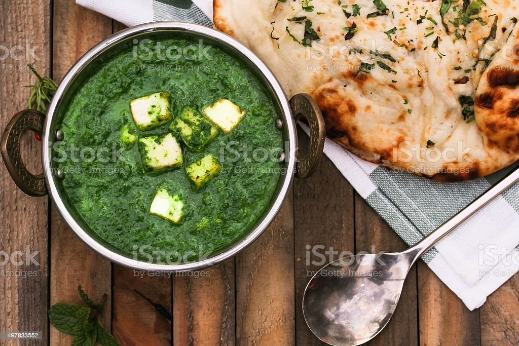 Palak Paneer and nan bread stock photo