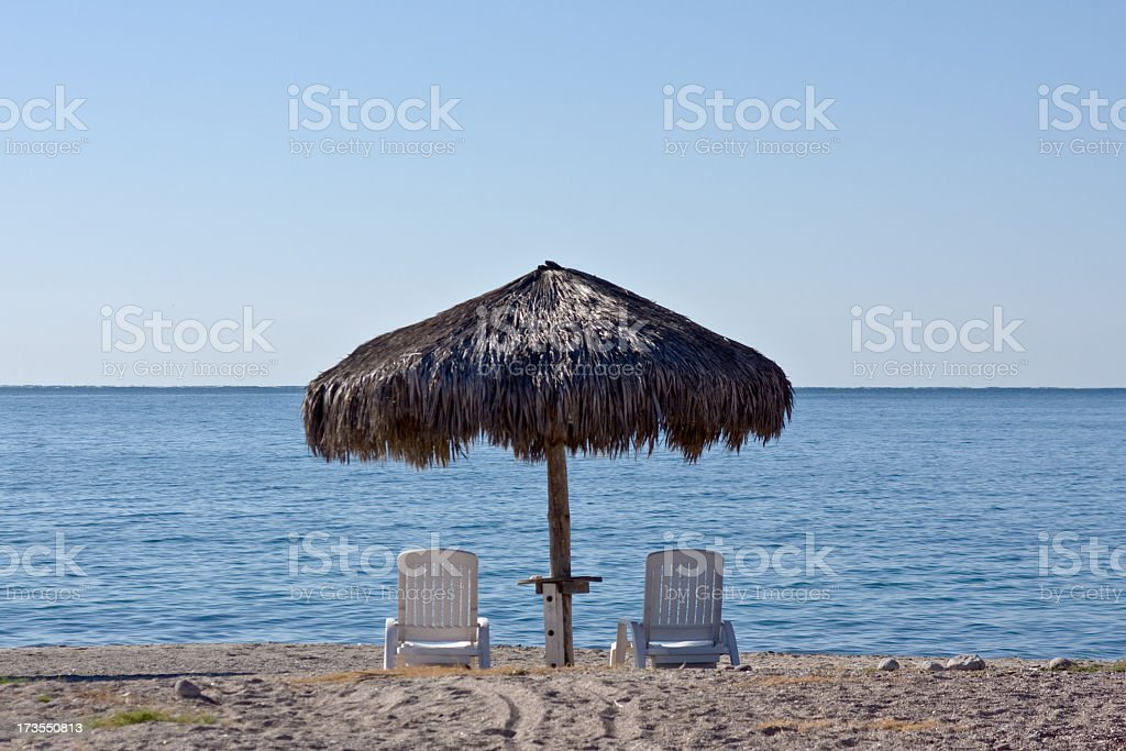Palapa and Chairs royalty-free stock photo