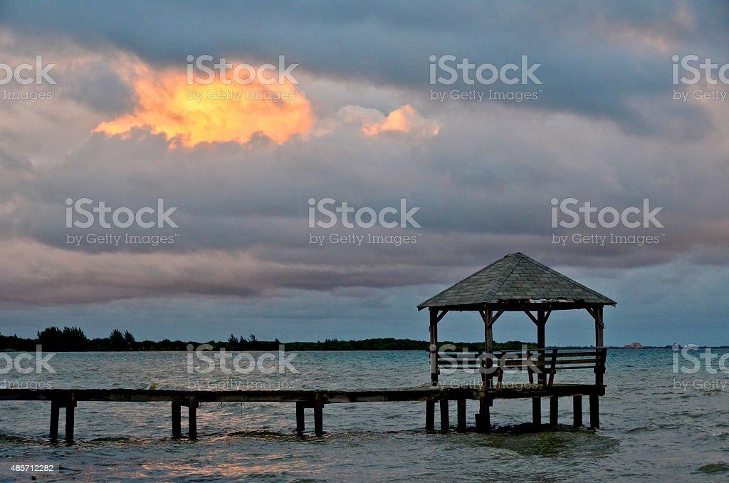 Palapa and pier stock photo