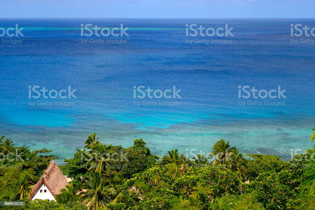 Palapa and Tropical paradise from above: Dreamlike Sand deserted turquoise beach and palm trees, Idyllic Yasawas, Fiji Islands stock photo