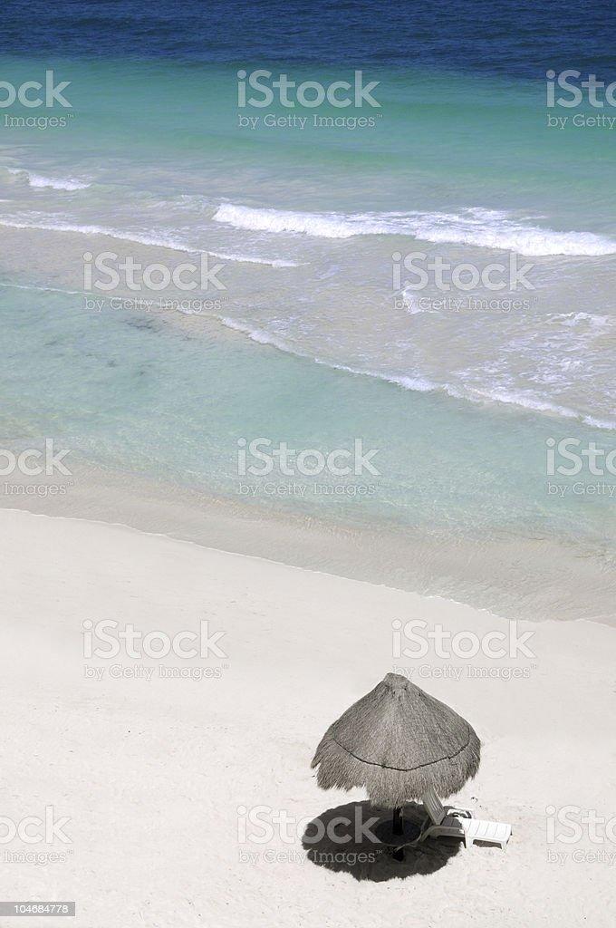 Palapa on a tropical beach stock photo