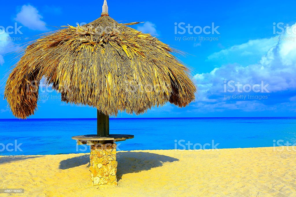 Palapa sunshade - Aruba beach, Dutch Antilles, Turquoise Caribbean stock photo