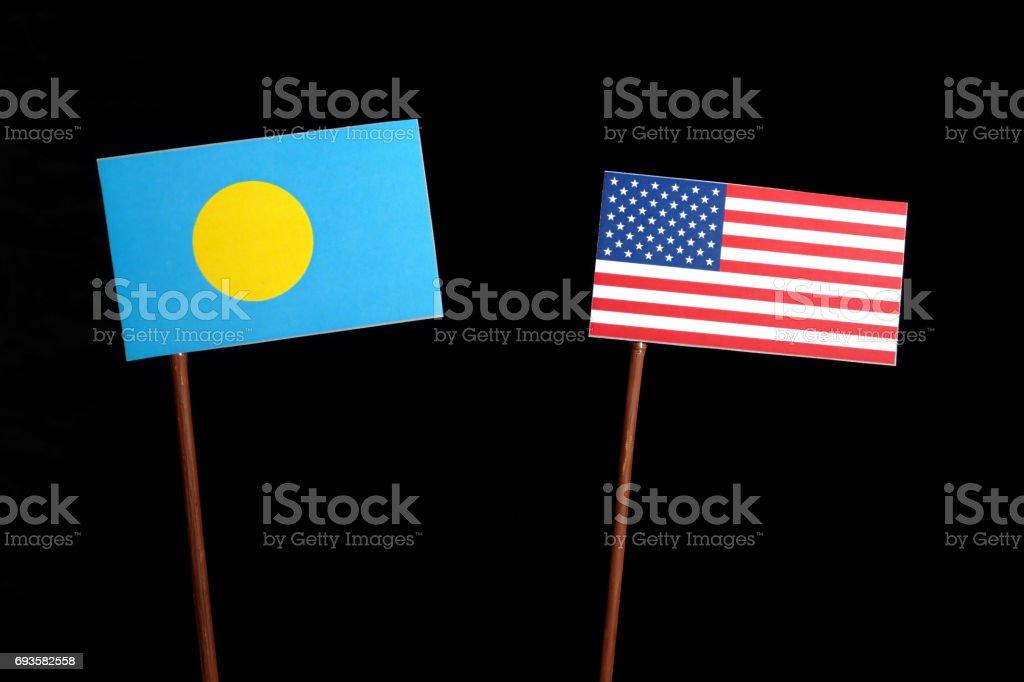 Palau flag with USA flag isolated on black background stock photo