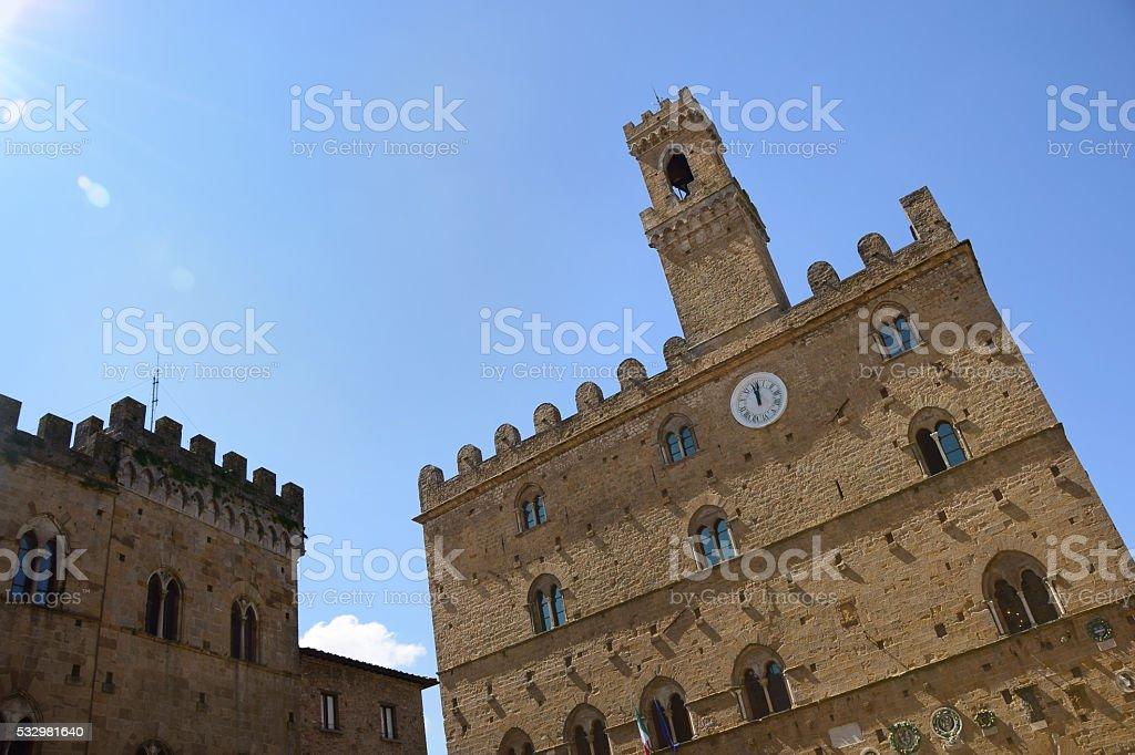 Palazzo Dei Priori Clock Tower in Volterra, Italy stock photo