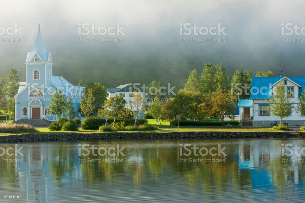 Pale blue church reflected stock photo