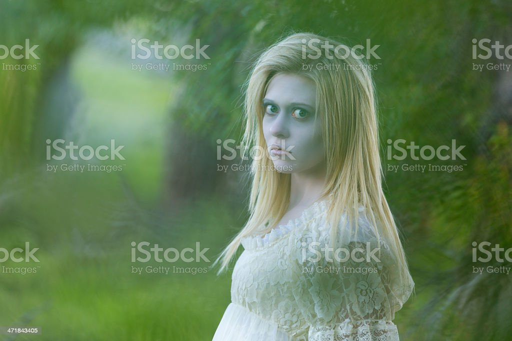 Pale faced ghost woman appearing outdoors royalty-free stock photo